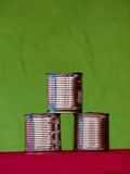 Pyramid of cans Stock Images