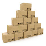 Pyramid of cardboard boxes on a white background Stock Image