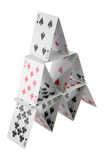 Pyramid of Cards. Pyramid shape made of stacked playing cards isolated on white Stock Images