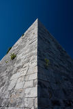 Pyramid of Cestius. The tip of the Cestius Pyramid in Rome royalty free stock photo