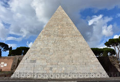 Pyramid of Cestius with beautiful sky. Ancient Pyramid of Cestius, a monument in the center of Rome Stock Image