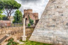 Pyramid of Cestius near Porta San Paolo, Rome, Italy. View of the Pyramid of Cestius and Porta San Paolo, iconic landmarks in Testaccio district, Rome, Italy Royalty Free Stock Photography