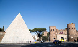 Pyramid of Cestius and San Paolo Gate in Rome. View of Pyramid of Cestius and San Paolo gate (porta San Paolo) in Rome, Italy Stock Photography