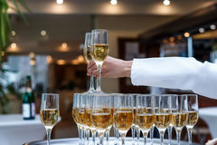 A pyramid of champagne. Beautiful restaurant interior table decoration for wedding royalty free stock photos