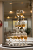 A pyramid of champagne. Beautiful restaurant interior table decoration for wedding royalty free stock photo
