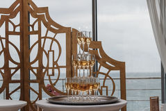 A pyramid of champagne. Beautiful restaurant interior table decoration for wedding stock photos