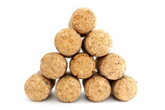 Pyramid of champagne corks Stock Photos