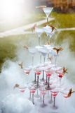 Pyramid of Champagne Glasses with Dry Ice Vapor Stock Image