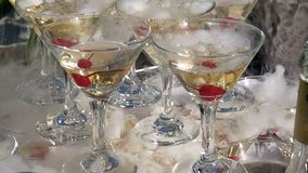 Champagne with the cherries. Pyramid from champagne glasses Hill with smoke stock footage