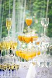 Pyramid of champagne glasses in holliday. Pyramid of champagne glasses in wedding Royalty Free Stock Photo