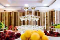 Pyramid champagne martini glasses. On the table in restaurant Stock Photos