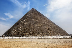 The pyramid of Cheops in Giza,Cairo, Egypt. The pyramid of Cheops in Giza in the sunny day, Cairo, Egypt Stock Photography