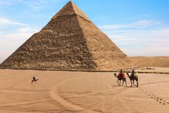 The Pyramid of Chephren and bedouins in the desert of Giza, Egypt.  royalty free stock images