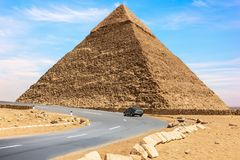The Pyramid of Chephren and a car road nearby, Giza, Egypt.  stock photos