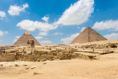 The pyramid of Chephren and the Great Sphinx of Giza in spring. The Great Pyramid of Giza is a defining symbol of Egypt and the last of the ancient Seven Wonders stock images