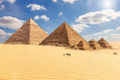 The Pyramid of Chephren, the Pyramid of Menkaure and its companions in the sands of Giza desert, Egypt.  royalty free stock photo