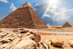 The Pyramid of Chephren, the Pyramid of Menkaure, view from the road in the desert. Africa, ancient, animal, arab, archeology, architecture, blue, building stock photos