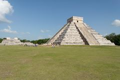 Pyramid in Chichen Itza Mexico. The imposing Pyramid of El Castillo for god Kukulcan, the plume serpent, and the facade of the Warriors temple with its columns Stock Image