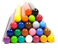 Pyramid from children's color pencils. On white stock image