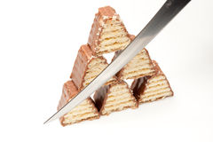 Pyramid of chocolate. Chocolate pyramid sliced by a knife Stock Images