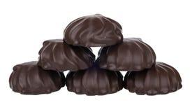 Pyramid of chocolate marshmallows isolated on white Royalty Free Stock Photo