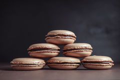 Pyramid of Chocolate pastel brown Macarons or Macaroons royalty free stock images