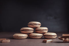 Pyramid of Chocolate pastel brown Macarons or Macaroons royalty free stock photography