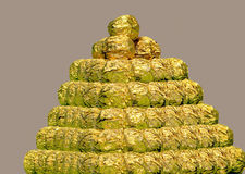 Pyramid of chocolates. A pyramid of chocolates covered in textured gold foil Royalty Free Stock Image