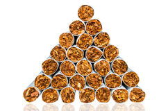 Pyramid of cigarettes. closeup isolated on white background Royalty Free Stock Photos