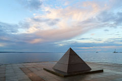 Pyramid on city lake quay in summer Stock Photos