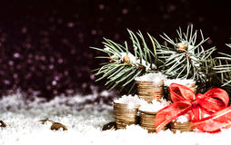 Pyramid of coins and the coins scattered over in the snow Stock Images