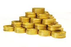 Pyramid from coins of yellow metal Royalty Free Stock Images