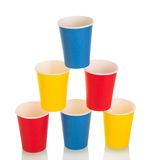 Pyramid of colorful disposable paper cups isolated on white. Royalty Free Stock Image