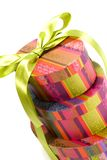 Pyramid of colorful gift boxes. With green bow on white background Stock Images