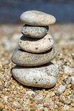 Pyramid of colorful pebbles . Rock Zen in the background of the sea. Concept of harmony and balance. Beautiful pyramid of colorful pebbles . Rock Zen in the Royalty Free Stock Photography