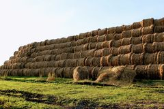The pyramid is composed of hay balls in the rays of sunset Stock Photo