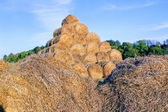 The pyramid is composed of hay balls in the rays of sunset Royalty Free Stock Photo