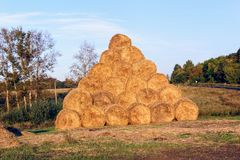 The pyramid is composed of hay balls in the rays of sunset Royalty Free Stock Photography