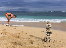 Pyramid of the corals and surfer girl with board Stock Photo