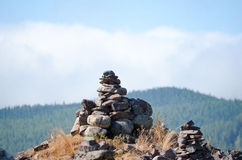 A pyramid of desires from stones in the mountains. Stock Image