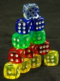 Pyramid Dice. Colored dice stacked in a pyramid Royalty Free Stock Photography