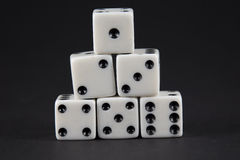 Pyramid of dice showing numbers one to six Stock Photo