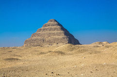 Pyramid of Djoser. The Pyramid of Djoser (or Zoser), or step pyramid (kbhw-ntrw in Egyptian) is an archeological remain in the Saqqara necropolis, Egypt royalty free stock photo