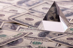 Pyramid on dollars Stock Images