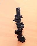 Pyramid of dominoes Stock Photo