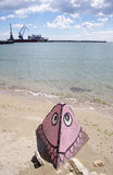 Pyramid with a drawing of a fish and port Balchik , Bulgaria Royalty Free Stock Photos