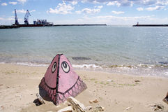 Pyramid with a drawing of a fish and small port Balchik , Bulgar Royalty Free Stock Photo