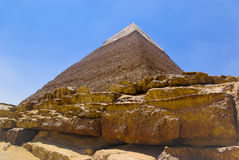 Pyramid in Egypt - big stones close-up. Pyramid and desert in Giza, Cairo, Egypt. Big stones close-up on the blue sky backdrop Royalty Free Stock Image