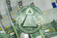 Pyramid, Eye of Providence above 100 euros banknotes. Macro Royalty Free Stock Image