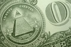 Pyramid, eye of providence, and O of ONE on back of an American single. stock image